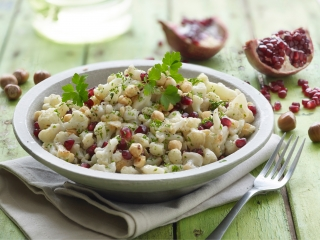 image of Cauliflower & pomme granate salad with hazelnuts