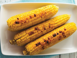 image of Grilled corn cobs on the BBQ